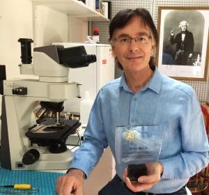 John Stuart Reid holds Cymatics Award 2017